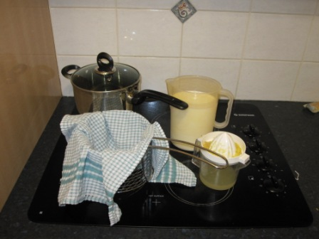 A big saucepanm, strainer lined with tea towel, 1l milk, lemon juice.